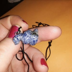 Thin necklace with a coiled sodalite snake charm